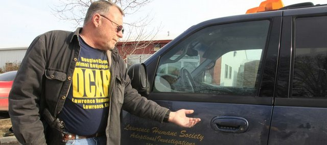 Mark Grinstead is among the employees at the Lawrence Humane Society who are carrying concealed weapons on the job. The shelter is the only one in the state that investigates all cruelty and neglect cases in its county, and workers occasionally encounter disgruntled people who have threatened workers' safety.