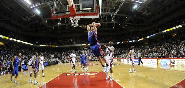 Kansas center Cole Aldrich pulls back for a two-handed jam before the Temple defense during the second half, Saturday, Jan. 2, 2010 at the Liacouras Center in Philadelphia, Pa.
