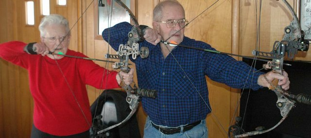Virginia and Tom McGee say their archery activities keep them youthful. Tom, 87, has been bow hunting since he was about 55 years old, and Virginia, 85, has been shooting three-dimensional targets since she was 72 years old.