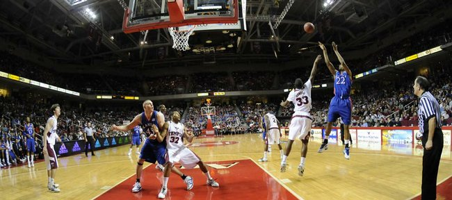 Kansas forward Marcus Morris puts up a shot over Temple forward Scootie Randall during the second half, Saturday, Jan. 2, 2010 at the Liacouras Center in Philadelphia, Pa.