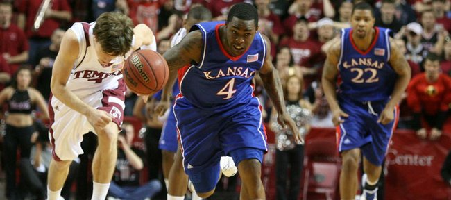 Kansas guard Sherron Collins charges up the court after stripping the ball from Temple guard Juan Fernandez during the first half, Saturday, Jan. 2, 2010 at the Liacouras Center in Philadelphia, Pa.