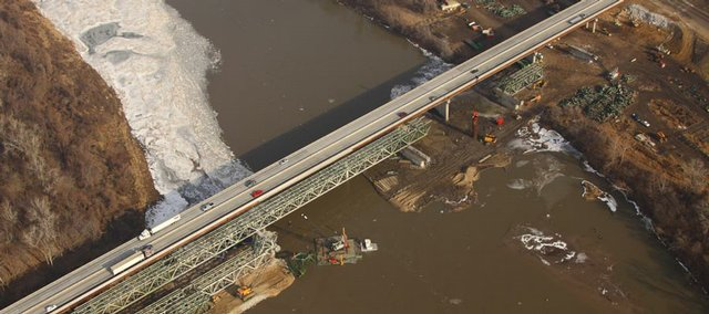 This aerial from Dec. 22, 2009, shows the new I-70 turnpike bridge to the north of the old bridge which is being demolished in a series of blasts this winter. This shot puts the west bank of the river on the left and east bank on right.