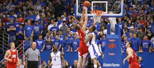 Kansas forward Marcus Morris hits Cornell center Jeff Foote with a hard foul during the first half, Wednesday, Jan. 6, 2009 at Allen Fieldhouse.