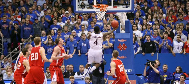 The Fieldhouse crowd watches as Sherron Collins penetrates the Cornell defense for a bucket to give the Jayhawks the lead late in the second half, Wednesday, Jan. 6, 2009 at Allen Fieldhouse.