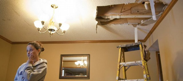 After returning with her family from a holiday vacation, Denise Correa found icicles hanging from her dining room ceiling and water line breaks in several parts of the house that she rents. Correa surveyed the damage and watched Monday as plumbers worked to repair the lines.