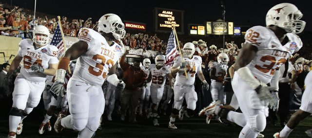 Texas runs onto the field at the Rose Bowl for the BCS Championship game against Alabama in Pasadena, Calif., on Thursday, Jan. 7, 2010.