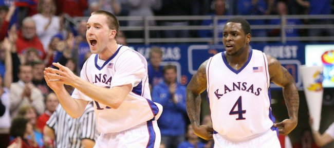 Kansas guard Brady Morningstar (left) celebrates a three pointer by teammate Tyrel Reed against Cornell during the second half, Wednesday, Jan. 6, 2009 at Allen Fieldhouse.