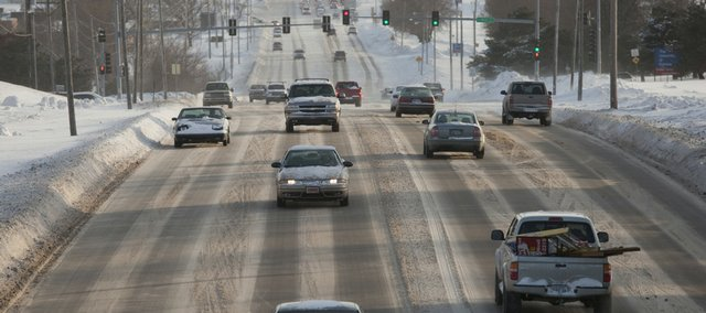 Vehicles travel Thursday on Iowa Street near 15th Street in this file photo.