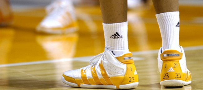 Tennessee senior J.P. Prince, in practice Friday in Knoxville, Tenn., displays the jersey numbers on his shoes of the four players suspended or dismissed from the team. Coach Bruce Pearl dismissed forward and team captain Tyler Smith on Friday.