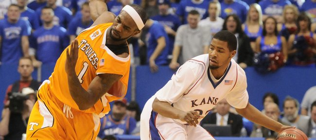 Tennessee forward Tyler Smith loses his balance trying to avoid Kansas forward Marcus Morris during the second half Saturday, Jan. 3, 2009 at Allen Fieldhouse.
