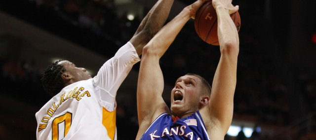 Kansas center Cole Aldrich battles for a rebound with Tennessee defenders Renaldo Woolridge and Steven Pearl during the first half Sunday, Jan. 10, 2009 at Thompson-Boling Arena in Knoxville.