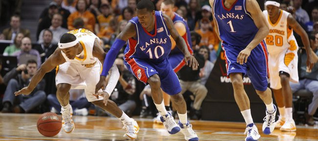 Kansas guard Tyshawn Taylor and Tennessee guard Scotty Hopson race for a loose ball during the first half Sunday, Jan. 10, 2009 at Thompson-Boling Arena in Knoxville.