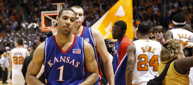 Dejected Kansas players Xavier Henry (1) and Cole Aldrich make their way from the floor after the Jayhawks' 76-68 loss to Tennessee Sunday, Jan. 10, 2009 at Thompson-Boling Arena in Knoxville.