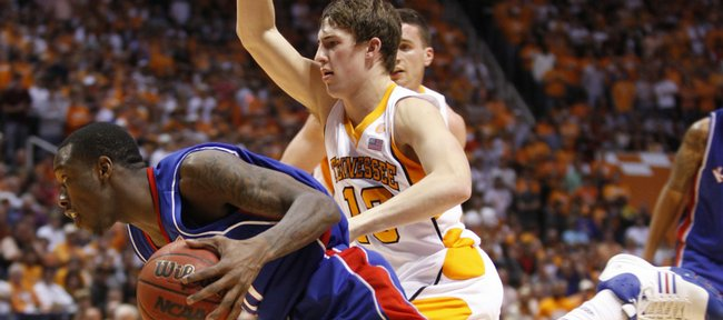 Kansas guard Tyshawn Taylor drives around Tennessee guard Skylar McBee during the second half Sunday, Jan. 10, 2010 at Thompson-Boling Arena in Knoxville.