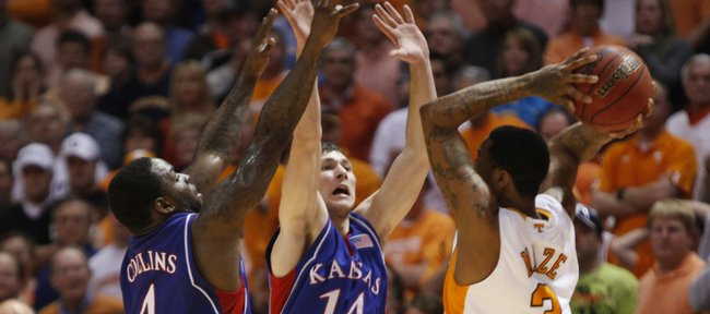 Kansas defenders Sherron Collins (4) and Tyrel Reed (14) look to trap Tennessee guard Bobby Maze late in the second half Sunday, Jan. 10, 2010 at Thompson-Boling Arena in Knoxville.