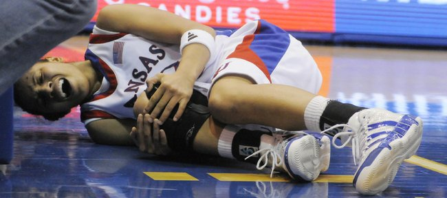 Kansas guard Angel Goodrich goes down with a hurt knee injury Tuesday, Jan. 12, 2010 at Allen Fieldhouse. Oklahoma State outlasted the Jayhawks with a layup to win in the final seconds.