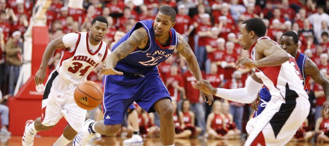 Kansas forward Marcus Morris comes away with a loose ball after knocking it away from Nebraska's Lance Jeter (34) and Brandon Richardson (3) during the second half Wednesday, Jan. 13, 2010 at the Devaney Center in Lincoln, Nebraska.