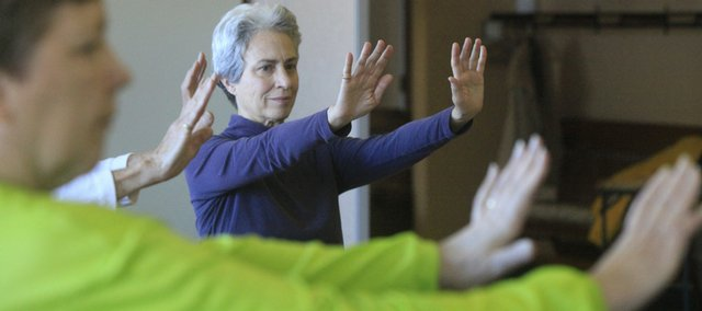 Jill Kleinberg, 64, Lawrence, attends a Tai Chi class Wednesday sponsored by the Lawrence Parks and Recreation Department at the Lawrence Senior Center. A study by researchers at Kansas University's School of Social Welfare has concluded that Lawrence has much to gain economically from attracting retirees.