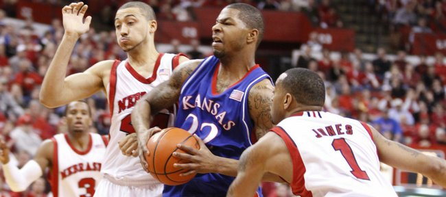 Kansas forward Marcus Morris breaks through Nebraska defenders Ryan Anderson, (44) and Eshaunte Jones (1) during the first half Wednesday, Jan.
