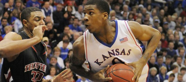 Kansas forward Thomas Robinson makes a move on Texas Tech's Mike Singletary Saturday, Jan. 16, 2010 at Allen Fieldhouse.