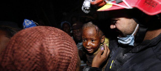 Two-year-old Redjeson Hausteen Claude reacts to his mother, Daphnee Plaisin, after he is rescued Thursday night from a collapsed home by Belgian and Spanish rescuers in the aftermath of the powerful earthquake in Port-au-Prince. A 7.0-magnitude earthquake struck Haiti on Tuesday, and time is running out to rescue anyone who may still be trapped alive in the many buildings.