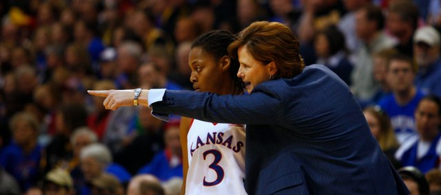 KU coach Bonnie Henrickson talks with guard Rhea Codio (3) during the second half of the game on Sunday, Jan. 17, 2010, at Allen Fieldhouse.