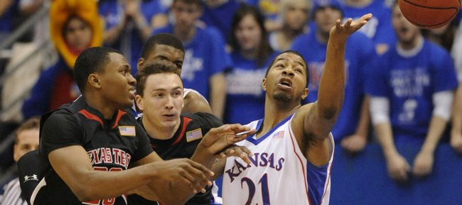 Kansas center Markieff Morris goes for the ball against Tech defenders Theron Jenkins (left) and Darko Cohadarevic Saturday, Jan. 16, 2010 at Allen Fieldhouse.