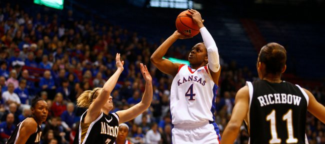 KU's Danielle McCray (4) pulls up for a jumper in front of Missouri's Amanda Hanneman (3) during the first half of the game on Sunday, Jan. 17, 2010, at Allen Fieldhouse.