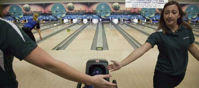 Free State senior Christina Picicci, right, gets a high five after a strike. The Firebird girls finished second on Tuesday at Royal Crest Lanes.