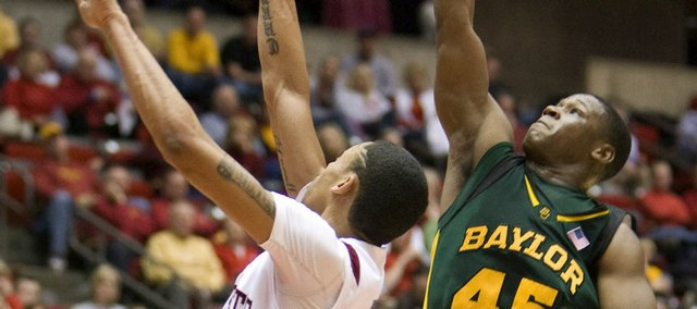 Baylor's Tweety Carter (45) shoots over Iowa State's Diante Garrett in this file photo from Feb. 24, 2009, in Ames, Iowa. Tweety and the Bears face off against the Jayhawks at 8 tonight at Allen Fieldhouse.