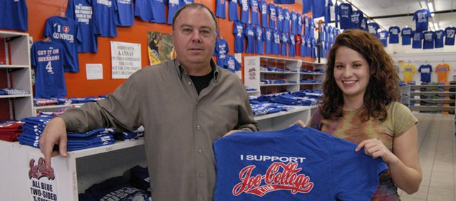 Larry Sinks, owner of Joe College, with benefit organizer Hollie Farrahi.
