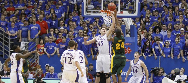 Kansas center Cole Aldrich defends Baylor guard LaceDarius Dunn's floater during the first half, Wednesday, Jan. 20, 2010 at Allen Fieldhouse.