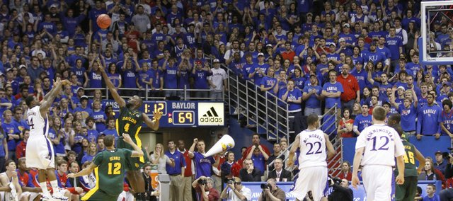 The Allen Fieldhouse crowd watches Kansas guard Sherron Collins put up a three-pointer over Baylor forward Quincy Acy with 1:12 left in the game to boost the Jayhawks over the Bears Wednesday, Jan. 20, 2010 at Allen Fieldhouse.