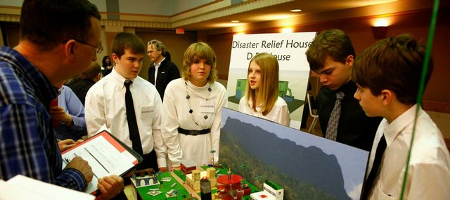 West Junior High students, from left, Caleb Ledbetter, Abby Schletzbaum, Addison Bollaert, Noah Kenn and David Glauner present their project to judges Saturday at the Great Plains Region Future City Competition. The event took place at the Kansas Union on the Kansas University campus.