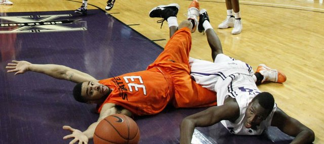 K-State's Curtis Kelly, right, and Oklahoma State's Marshall Moses battle for a loose ball. OSU knocked off No. 10 K-State, 73-69, on Saturday in Manhattan.
