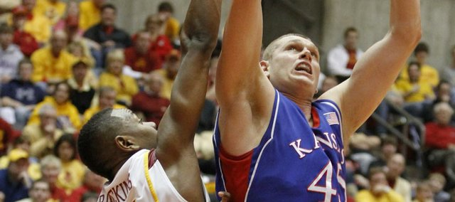 Kansas center Cole Aldrich takes it to the bucket over Iowa State forward Craig Brackins during the first half, Saturday, Jan. 23, 2010 at Hilton Coliseum in Ames, Iowa.