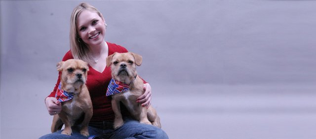 Kristin Howard is pictured with her dogs. She has spent about $1,000 a year on each of them in veterinary care.