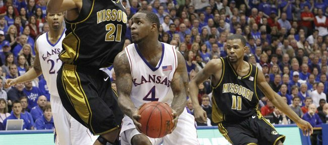 Kansas guard Sherron Collins cuts under Missouri forward Laurence Bowers to the bucket during the first half, Monday, Jan. 25, 2010 at Allen Fieldhouse.