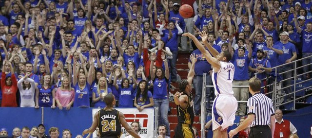 Kansas forward Xavier Henry pulls up from the corner over Missouri defenders Marcus Denmon and Kim English (24) during the second half, Monday, Jan. 25, 2010 at Allen Fieldhouse.