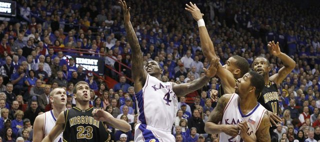 Kansas guard Sherron Collins cuts through the Missouri defense for a shot during the first half, Monday, Jan. 25, 2010 at Allen Fieldhouse.