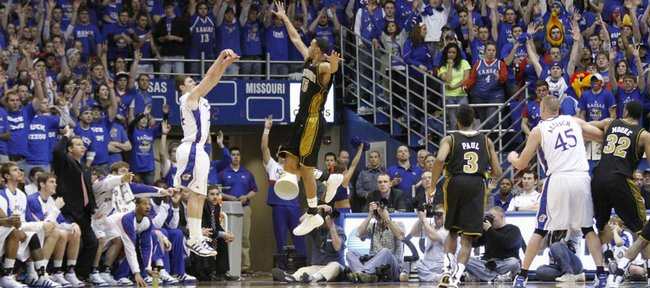 The Fieldhouse crowd rises to its feet as Kansas guard Tyrel Reed hits a three pointer over Missouri forward Keith Ramsey during the second half, Monday, Jan. 25, 2010 at Allen Fieldhouse.