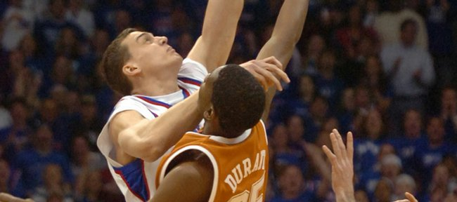 Kansas University's Sasha Kaun, left, and Texas' Kevin Durant jump for the opening tip. The Longhorns built a 16-point lead late in the first half, but Kansas chipped away and won the outright Big 12 Conference regular-season title with a 90-86 victory on March 3, 2007, in Allen Fieldhouse.