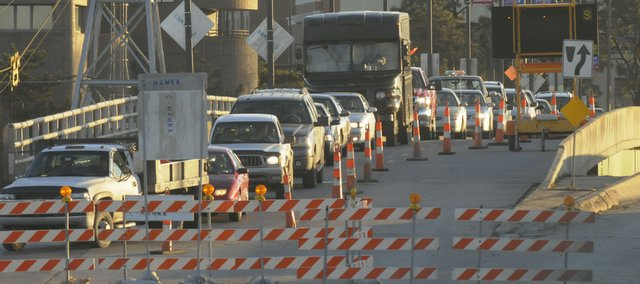 Traffic backs up over the Kansas River bridge Tuesday evening from downtown into North Lawrence, as reconstruction continues at the intersection of North Second and Locust streets. Because the roadblocks are scheduled to remain until March 26, the Kansas Turnpike has agreed to wait until April 5 to close its East Lawrence interchange  a move to preserve another access for emergency vehicles into North Lawrence.