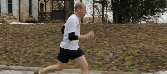In January, Joe Farthing, Lawrence, was training to compete in his first marathon — the Lynn Electric 2010 Kansas Marathon. He is among at least 200 people who will compete Sunday in the race, which benefits Health Care Access clinic.