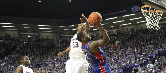 Kansas guard Sherron Collins gets a bucket over Kansas State forward Wally Judge after being fouled with seconds remaining in overtime Saturday, Jan. 30, 2010 at Bramlage Coliseum.