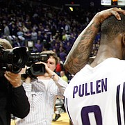 Chicago natives Jacob Pullen and Sherron Collins embrace after the Jayhawks' 81-79 win over the Wildcats after overtime, Saturday, Jan. 30, 2010 at Bramlage Coliseum.