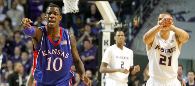 Kansas guard Tyshawn Taylor points to injured teammate Markieff Morris after intentionally fouling Kansas State guard Denis Clemente to stop play during the first half Saturday, Jan. 30, 2010 at Bramlage Coliseum.