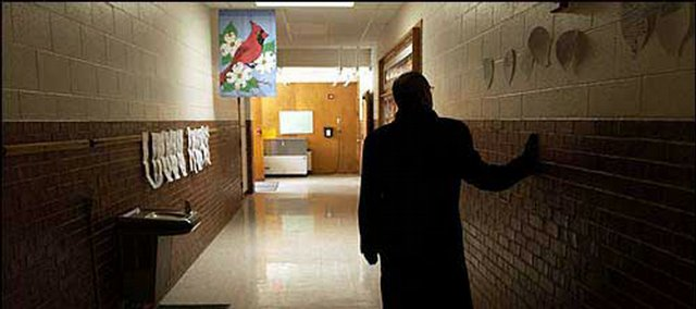Supt. Randy Weseman walks along a Centennial School hallway in this photo from March 2003 on a tour of the building. Under the facility master plan, Centennial would be closed and its students moved to another school. Because of Centennial's proximity to Lawrence High School, Weseman envisioned the elementary school being used for special LHS activities.