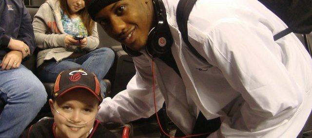Miami Heat player Mario Chalmers, a former Kansas University player, poses for a picture with Michael Douglas of Wellsville. Michael attended Miami Heat's Jan. 16 game in Oklahoma City against the Thunder.