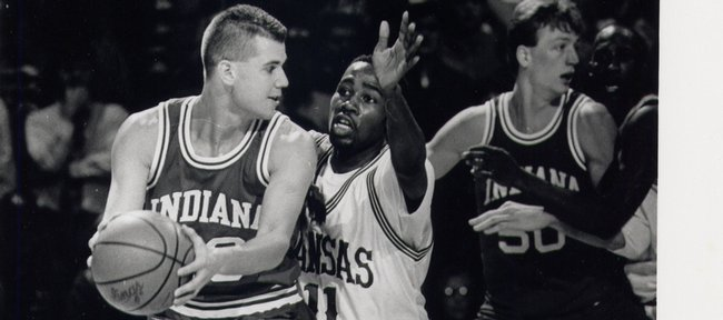 Kansas University's Jacque Vaughn (11) defends an Indiana player. Vaughn later hit the game-winning shot, a guarded three-pointer, in KU's 86-83 overtime victory over the Hoosiers on Dec. 22, 1993.